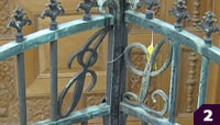 Bronze gates with J and L initials