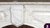 Carrera marble mantel with shield medallion