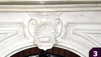 Parlor style white marble mantel with shell medallion