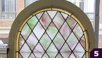 Arched pink and green stained glass
