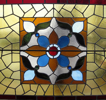 Blue, tan and yellow stained glass